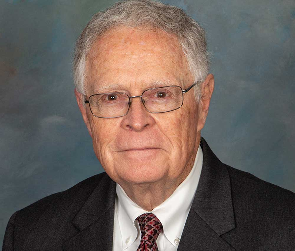 portrait of texas lawyer david christian in suit wearing glasses